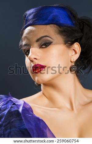 Sexy young woman in fashion dress on a dark background - stock photo