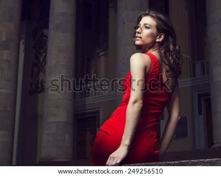 Sexy young woman in red dress - stock photo