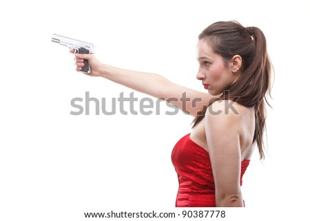 Sexy young woman in red with a gun isolated on white