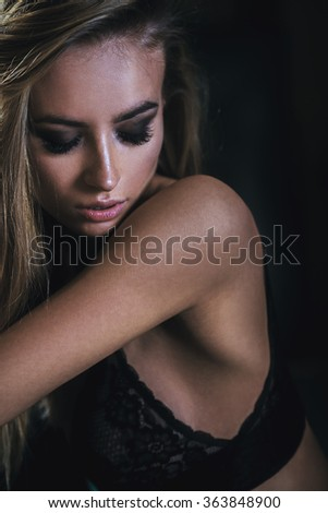 Sexy young woman in sexy black lingerie. Glamour Closeup Portrait