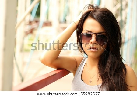 Sexy young woman in sunglasses outdoors