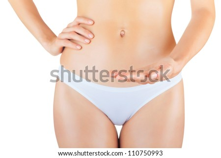 Sexy young woman in white panties isolated on white background. Focus on the hand