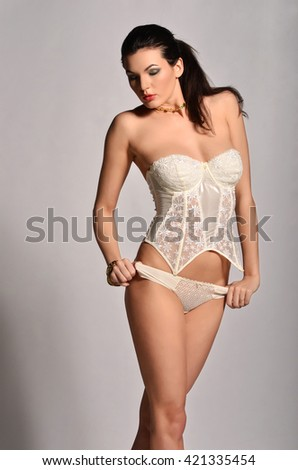 Sexy young woman in white seductive lingerie.