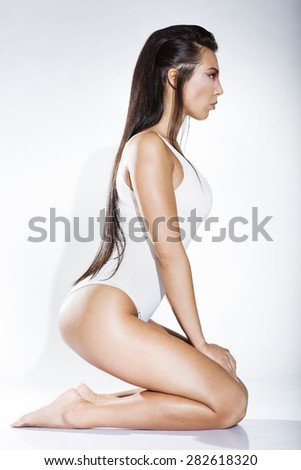 Sexy young woman kneeling,