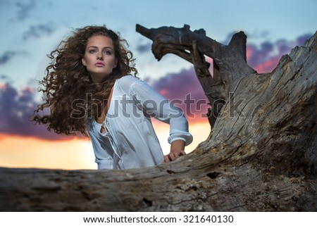 Sexy young woman on a beach - stock photo