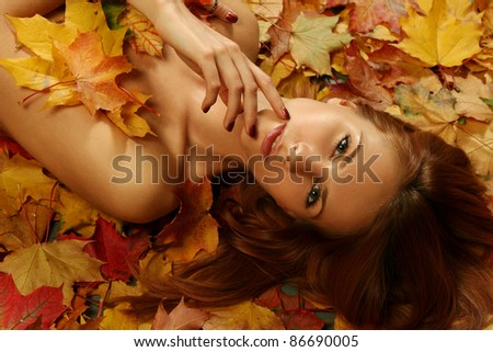 sexy young woman on bright leaves
