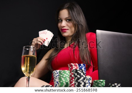 stock-photo-sexy-young-woman-playing-poker-online-holding-royal-flush-251868598.jpg