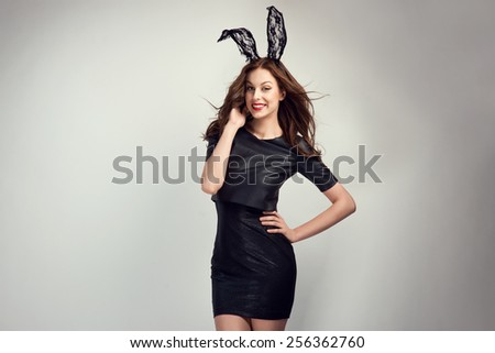 Sexy young woman posing in lace bunny ears - stock photo