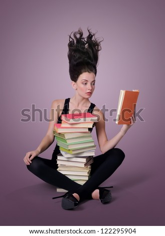 Sexy young woman reading a book, learning concept - stock photo