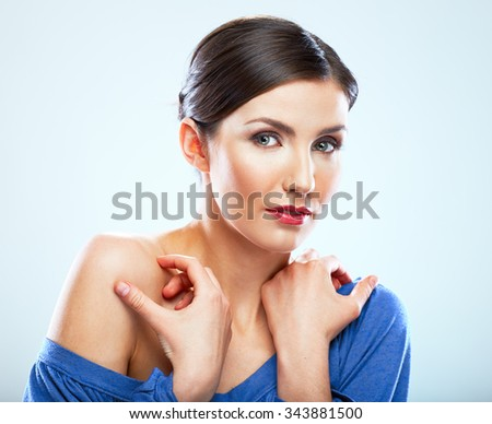 Sexy young woman touching neck. Beauty portrait with clear skin. Naked shoulder, sensual posing. - stock photo