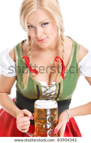 sexy young woman wearing a dirndl with beer mug over white - stock photo