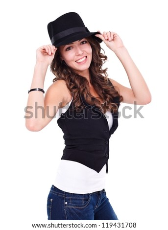 Sexy young woman wearing black hat over white background - stock photo