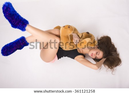 sexy young woman wearing pink shorts with a teddy bear - stock photo