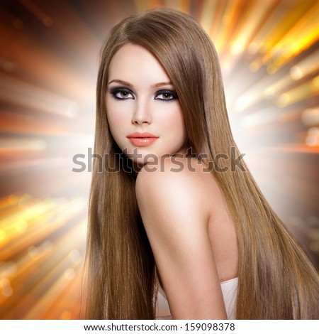 Sexy young woman with beautiful long straight  hair and attractive face