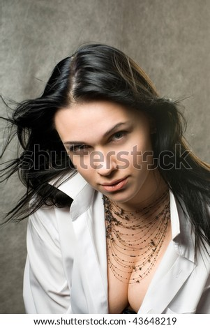 Sexy young woman with dark hair in a man's white shirt. - stock photo