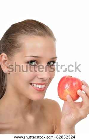 Sexy young woman with green eyes holding an apple
