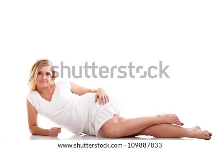 Sexy young woman with long legs lying on floor