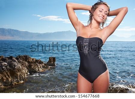 Sexy young womans body in bikini - stock photo