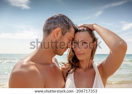 sexy younger parents couple on the beach
