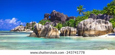 Seychelles  - panorama with impressive granite rocks in La Digue - stock photo