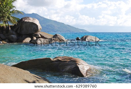 Seychelles wild rocks in the Indian ocean on Mahe, Seychelles sunny day