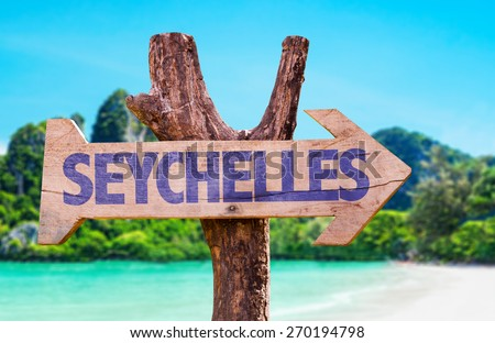 Seychelles wooden sign with beach background - stock photo
