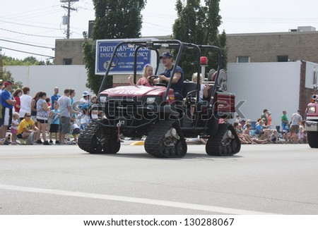 SEYMOUR, WI - AUGUST 4:  Front of Kawasaki Mule UTV with tracks Fire Department Vehicle at the Annual Hamburger Festival Parade on August 4, 2012 in Seymour, Wisconsin.