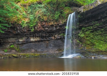 Sgwd Gwladus Waterfall in Brecon Beacons National Park, Wales. - stock photo