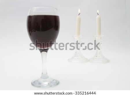 Shabbat table. Candles and Sabbath kiddush cup, isolated on a white background. - stock photo