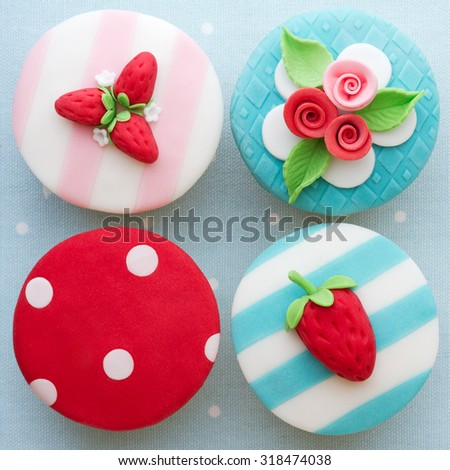Shabby chic cupcakes decorated with fondant - stock photo