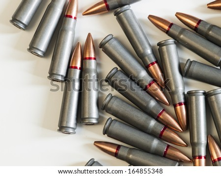 Shabby Kalashnikov AK-47(7,62 mm) bullets. - stock photo