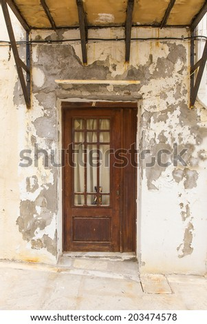 shabby old door in a medieval house - stock photo