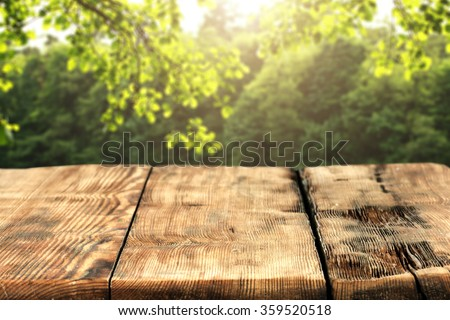 shabby wooden table place and spring time and green background
