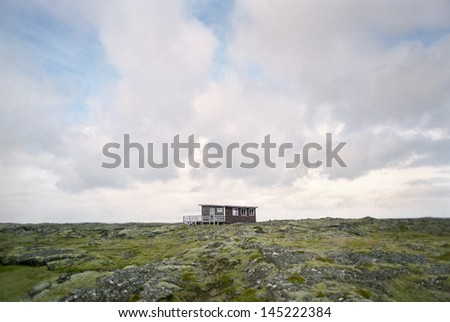 Shack in rugged landscape