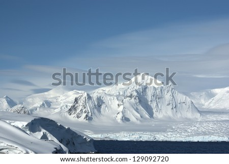 Shackleton Mountain in the west of the Antarctic Peninsula on a cloudy summer day.