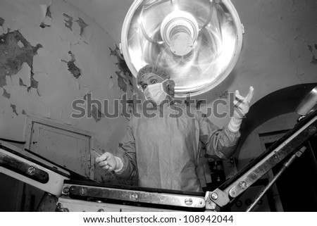 Shaded surgeon making fun before coming difficult surgery - stock photo