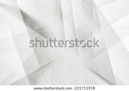 Shades of grey on the white folded paper - stock photo