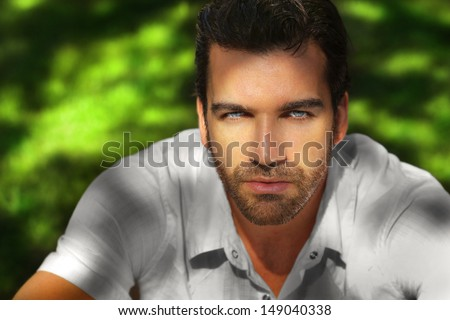 Shadow and light portrait of a beautiful young man - stock photo