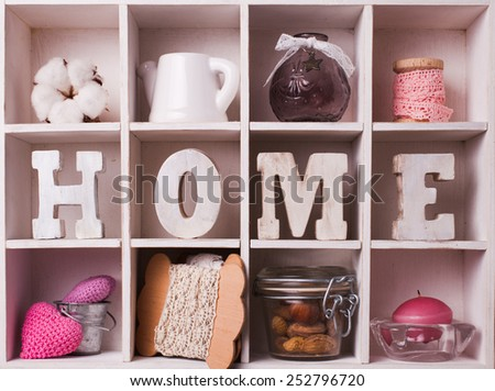 Shadow box with wooden letters home and cozy things - stock photo