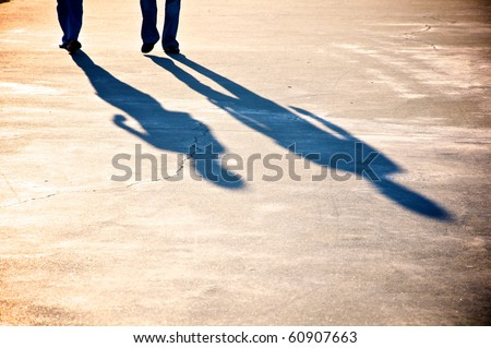 Shadow of a couple walking