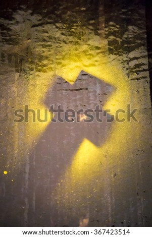 shadow of a cross on painted background - stock photo