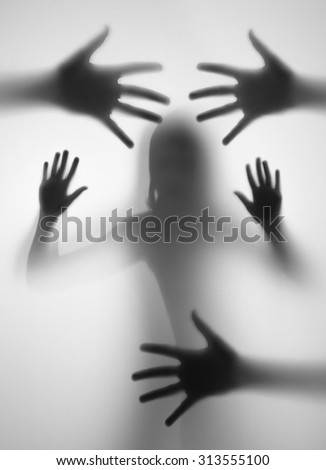 shadow of a hands behind transparent paper - stock photo
