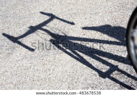 Shadow of a modern road bicycle against road pavement, in the morning