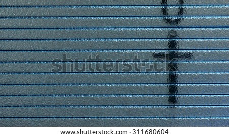 shadow of cross hanging behind the  plastic partition wall - stock photo
