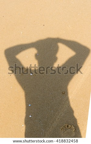 Shadow of Frustrated man with a headache on sand background. health concept . selective focus. - stock photo