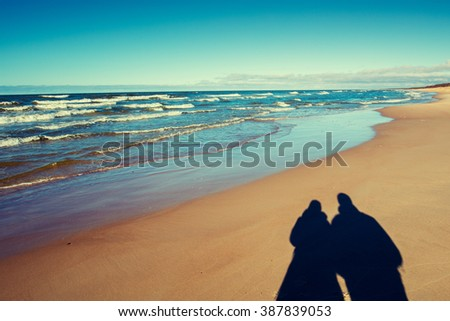 Shadow of man and woman on the beach