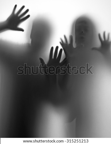 shadow of people behind transparent paper