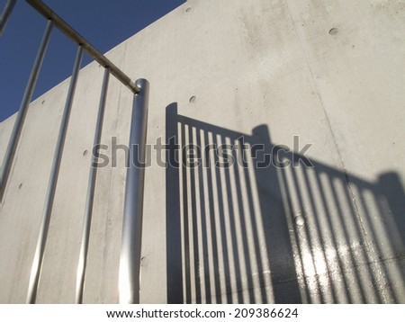 Shadow of the Concrete Wall and the Fence