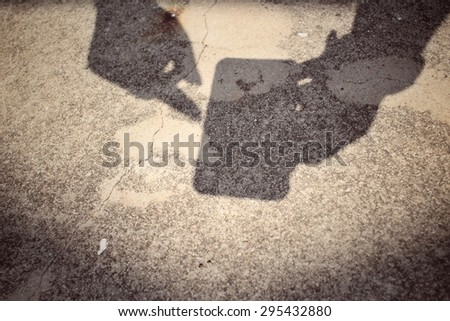 Shadow of using smart phone