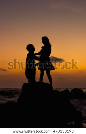 shadow romantic couple on the beach in sunset